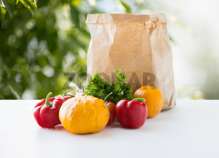 paper bag with vegetable food on table