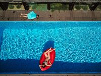 Woman is swimming on an inflatable lounger