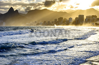 Cloudy sunset at Ipanema beach with light rays