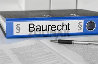 Blue folder with the german label Baurecht - Construction Law