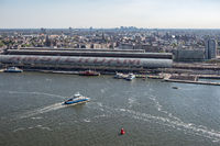 Aerial view medieval city Amsterdam with harbor central railway station
