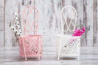 Decorative Pink and White Metal Cutlery Holders on White