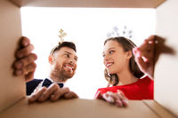 happy couple opening christmas gift box