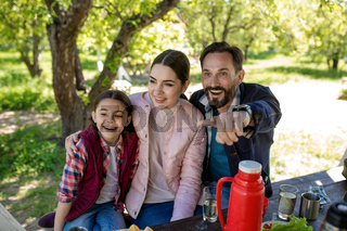 Happy family enjoy snack in park pavillion