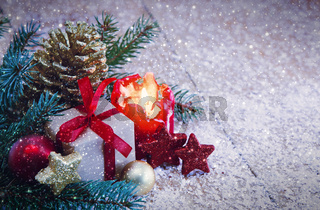 Red Advent candle and Christmas decoration. Christmas card .