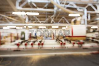 blurred factory workshop background