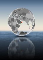 Oman on translucent globe above water