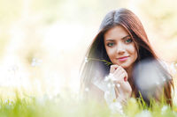 Pretty brunette girl laying on grass