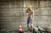 Sexy, muscular construction worker shirtless, outdoor shot