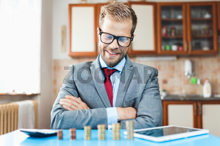 Working from home. Young businessman checking on returns from his investment