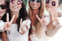 Girlfriends showing v sign