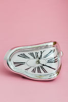 Clock with Distorted Soft Melting Design on Pink Background