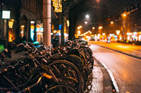 Bicycles parked along the road, night
