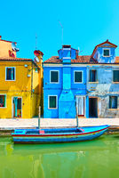 Colorful houses by canal in Burano