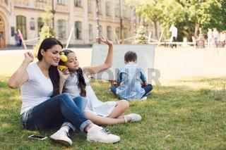 Children and teacher enjoy in park