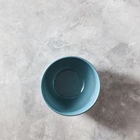 Blue porcelain bowl isolated on stone gray background, flat lay