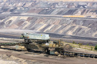 Brown coal open pit landscape with conveyor belt in Germany