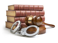 Judge gavel and handcuffs with legal book isolated on white background. Law and justice concept.
