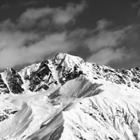 Black and white snow mountain peak at sunny day