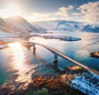 Aerial view of Fredvang bridges at sunset in winter
