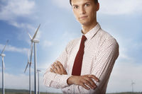 Businessman against the wind turbines