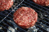 Raw beef burger for hamburger on barbecue grill