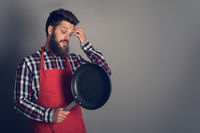 Male chef with frying pan