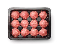 Top view of raw beef meatballs in plastic tray