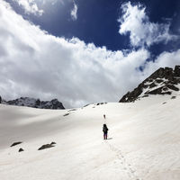 Two hikers in snowy mountains