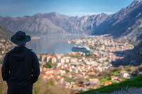 Tourist admiring Kotor town and Bay from above
