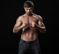 Muscular man on a black