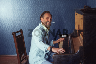 Brutal Man With a Beard 40 Years Old Plays the Old Piano.