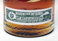 "excise stamp closeup on dark rum ""Havana Club"", produced in Cuba"