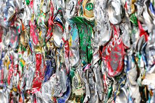 Metal drink cans from soft drinks squashed for recycling