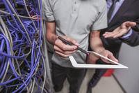 Engeneers in network server room