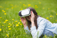 Woman in virtual reality headset outdoors