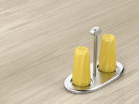 Salt and pepper shakers on silver holder