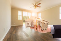 Handing Over Thousands of Dollars In Empty Room of House