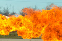 Flame tongues from the flamethrower. background of fire