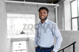 smiling african american businessman at office