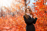 Young girl in sunny autumn forest