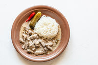 portion of Beef Stroganoff on white with copyspace