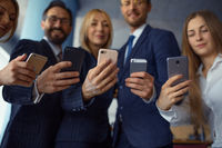 Businesspeople using phone