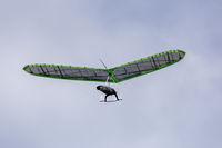 Hang Glider Soaring the Foggy Skies at Fort Funston, San Francisco.