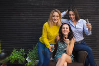 Group of partying girls with flutes with sparkling wine