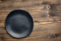 black plate on grained wood