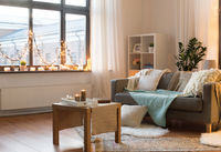 living room decorated by christmas garland at home