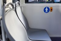 Red button STOP and Elderly (Old) People sign on the bus