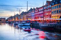 People Nyhavn harbor embankment, Sopenhagen