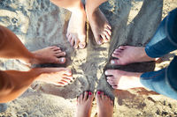 Top view image of feet of the female friends